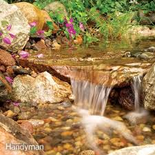 this cascading stream flows into a gravel bed not a pond so it stays clean with little maintenance
