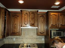 dark oak kitchen cabinets with stained in an
