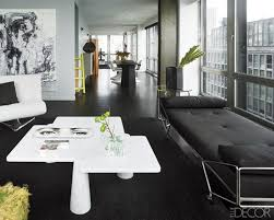 amazing mid century living room with black sofa bed and white sof black rug and white coffee table image