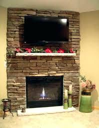 stone veneer fireplace surround over brick install stacked