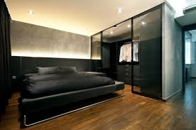 y moody bedroom designs urban bedroom with gray walls and a walk in closet behind glass