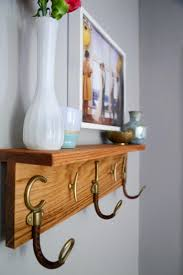 I love this entryway - it's beautiful! This DIY coat rack is so cute!