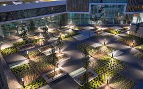 due to the sophisticated lighting system the courtyard can be used even at night illuminated roof garden at night plant beds with sedum