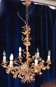 a large italian gold tole chandelier antique