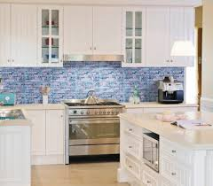 blue glass mosaic tile backsplash with simple white cabinet and classic island for cool kitchen ideas