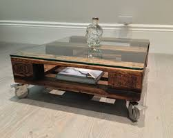 mini glass top upcycled wooden coffee table with castors