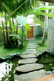 Ubud Villa Jo designed and built by Warren and Robbin Entry stepping stones  over lotus pond. Tropical Garden ...