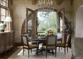 round table with leaf dining room traditional with arched doorway area rug
