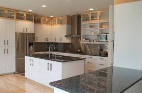 dark granite countertops with white cabinets best home renovation kitchens and stained tile floors