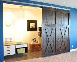 to finish off the doors use reclaimed timber to create the barn style effect on each door