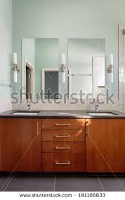bathroom vanity double sink. vanity double sink and mirrors in modern bathroom/vertical shot of a custom master bathroom