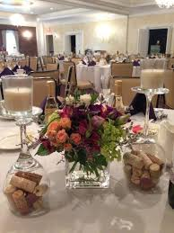 wine themed centerpieces - cork filled upside down wine glasses as candle  bases | event center