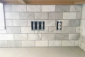 How To Grout Tile Backsplash Classy How To Install A Marble Subway Tile Backsplash Just A Girl And Her