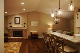 modern farmhouse style living room with kitchen great white chandeliers