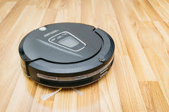 Robot Vacuum Cleaner On Laminate Wood Floor, Home Smart Robotic. Stock Image