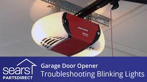 garage door won t close lights blink