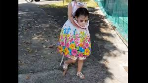 little girl goes trick or treating in headless costume