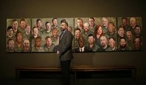 u s military veteran robert ferrara talks in front of a mural painted by former president george w bush during a press preview of an exhibition of bush s