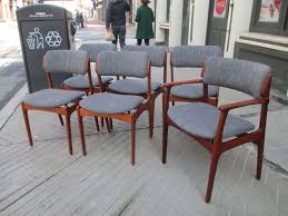set of six solid teak dining chairs five sides and on armed papas chair