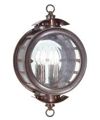 shown in heritage bronze finish and antique clear glass