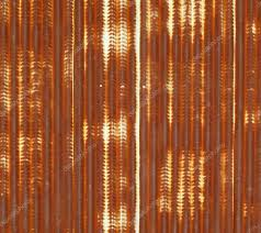 close up of corrugated metal with rust background photo by pockygallery