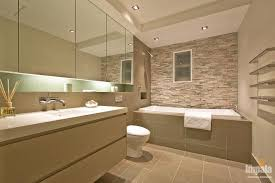 Consider bringing colour and interest into your bathroom design by tiling a  coloured feature wall as displayed in the image below.