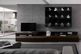 furniture dark brown wooden wall shelving unit with lcd tv on it connected by grey
