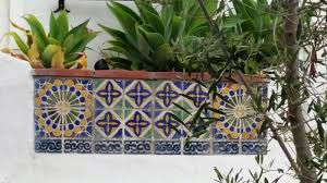 tiles patterns on this planter box are spanish and moorish influenced