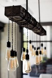 incredible edison bulb chandelier within nostalgic reclaimed wood dining room with