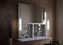 Bathroom Cabines with a Sleek Mirrored Door that Opens Upward