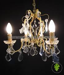 french bronze crystal chandelier supporting 4 candles