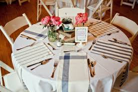 tea towel place settings as an alternative to table runners for round tables at your wedding reception