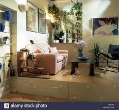 Split Level Living Room Pink Sofa In Modern Living Room With Storage Drawers In Split