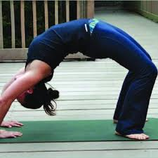 a person holding the yoga pose wheel this pose demonstrates that the spinal