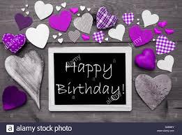 Chalkbord With Many Purple Hearts Happy Birthday Stock Photo