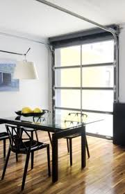 an aluminum and glass garage door becomes a window wall as well as a door to