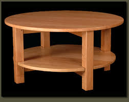 ... Wood Modern Coffee Tables Our Loescher Round Coffee Table Is Solid Yet  Elegant Its Lovely Curves And Wonderfully Practical Round ...