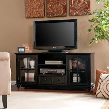 classic wooden tall narrow media entertainment storage in black finished with glass