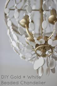 after discussing my inspiration for the chandelier here i decided that i wanted a matte gold metal and matte white beaded finish