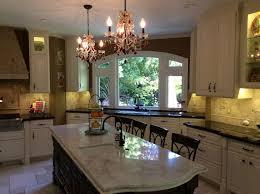 mediterranean chandeliers kitchen traditional with white cabinet white eat in kitchen white kitchen