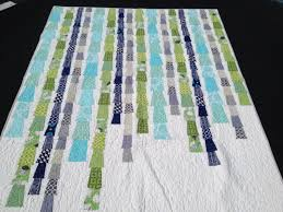 A blue, gray, navy, and green quilt using Elizabeth Hartman's Glam ... & I made this quilt about 3 columns wider than the original, and also about  15 inches longer, so that it would be approximately the same size as the  fire ... Adamdwight.com