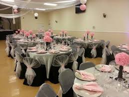 silver satin table cover pink napkins with rhinestone holder black chair covers and half