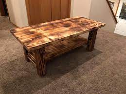 The wood is burnt 3 times thus giving it its rich, dark charcoal finish. Burnt Coffee Table The Clever Cleveland Concept Facebook