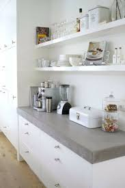white cement countertop in the pantry behind the kitchen counter kitchen with open shelves and a cement via white portland cement countertop mix