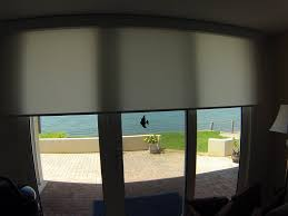 solar shades for sliding glass doors wonderful light filtering motorized roller shade on door from home