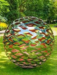 Modern garden sphere made from a lattice of stainless steel with a coloured  interior