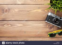 office table top. Camera, Sunglasses And Flower On Office Wooden Desk Table. Top View With Copy Space Table
