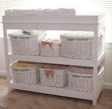 ... to convert back to a changing table. Features two large shelves and a  divided topper, perfect for a changing pad and keeping baby necessities at  hand.
