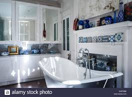 Blue And White Decorative Tiles Blue and white decorative tiles on mantlepiece in bathroom with 54