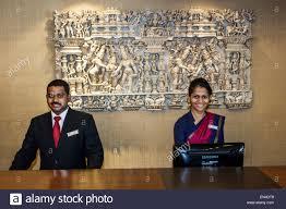 mumbai india asian churchgate veer nariman road the ambassador mumbai hotel front desk man woman coworkers reception employee job